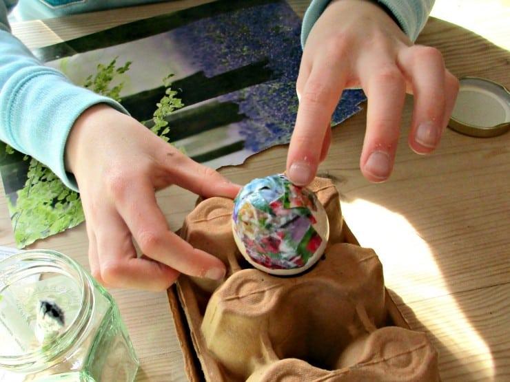 Easter Egg Decoupage - start sticking paper to egg