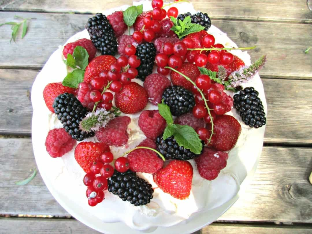 Pavlova, although fabulous at any time of the year, is a particular favourite of ours paired with summer berries. It is not difficult to make, providing you follow a few simple rules, and they really do make a stunning and delicious dessert.