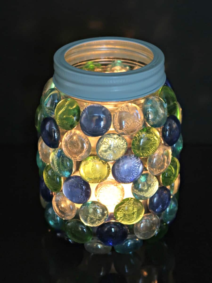 In this tutorial, we show you how to make your own beautiful glass gem lantern that is perfect to hold a candle or LED lights.