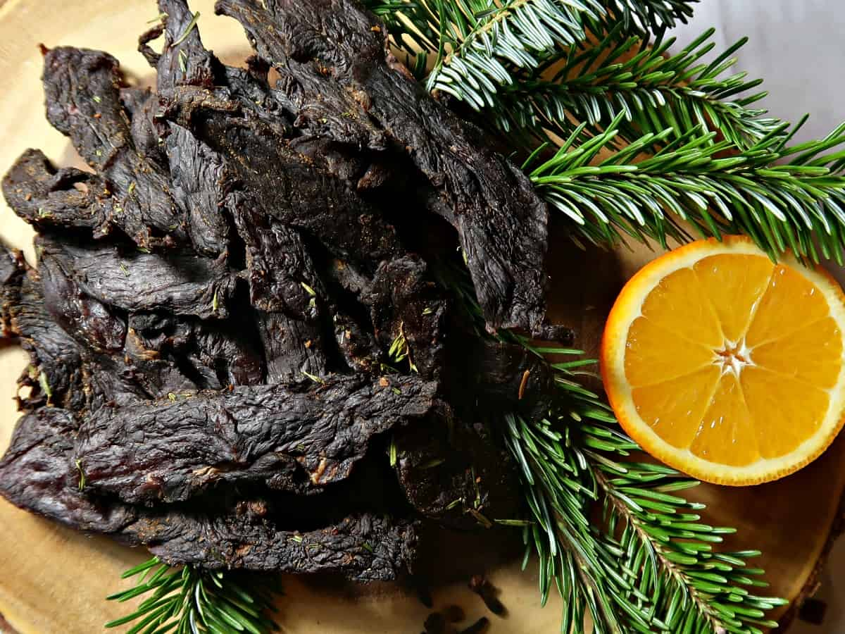 Our Christmas Venison Jerky recipe is perfect for the festive period with its marinade of spices, orange and pine needles. That said, it still tastes just as delicious whatever the time of year. #JerkyRecipe #Jerky #Dehydrator #Venison #WildGame #WildMeat #PineNeedles #WildFood #Foraging