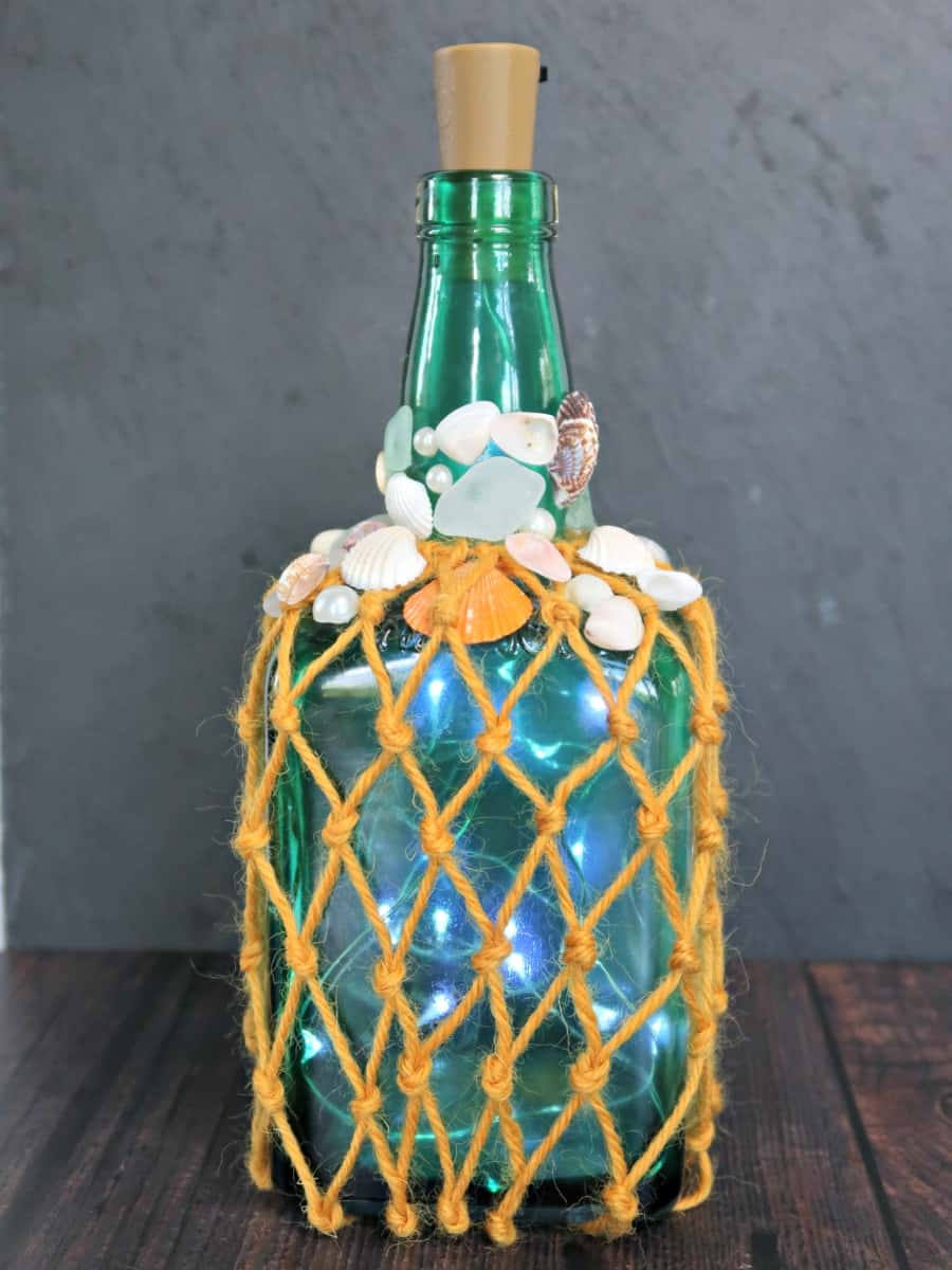 In this tutorial, I show you how to make tinted glass easily at home using Bostik PVA Glue. Before turning our pretty coloured glass into a beach themed light up bottle. #SeaGlass #ColouredGlass #TintedGlass #LEDLights #BottleLight #WineBottle #WineBottleUpcycle #BostikCrafts