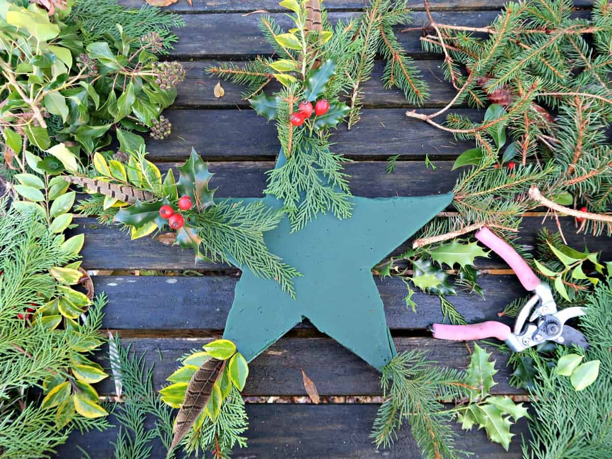 I show you how to cut a star wreath form from floral foam easily, and decorate it with fresh foliage to make a stunning star wreath to hang on your front door.