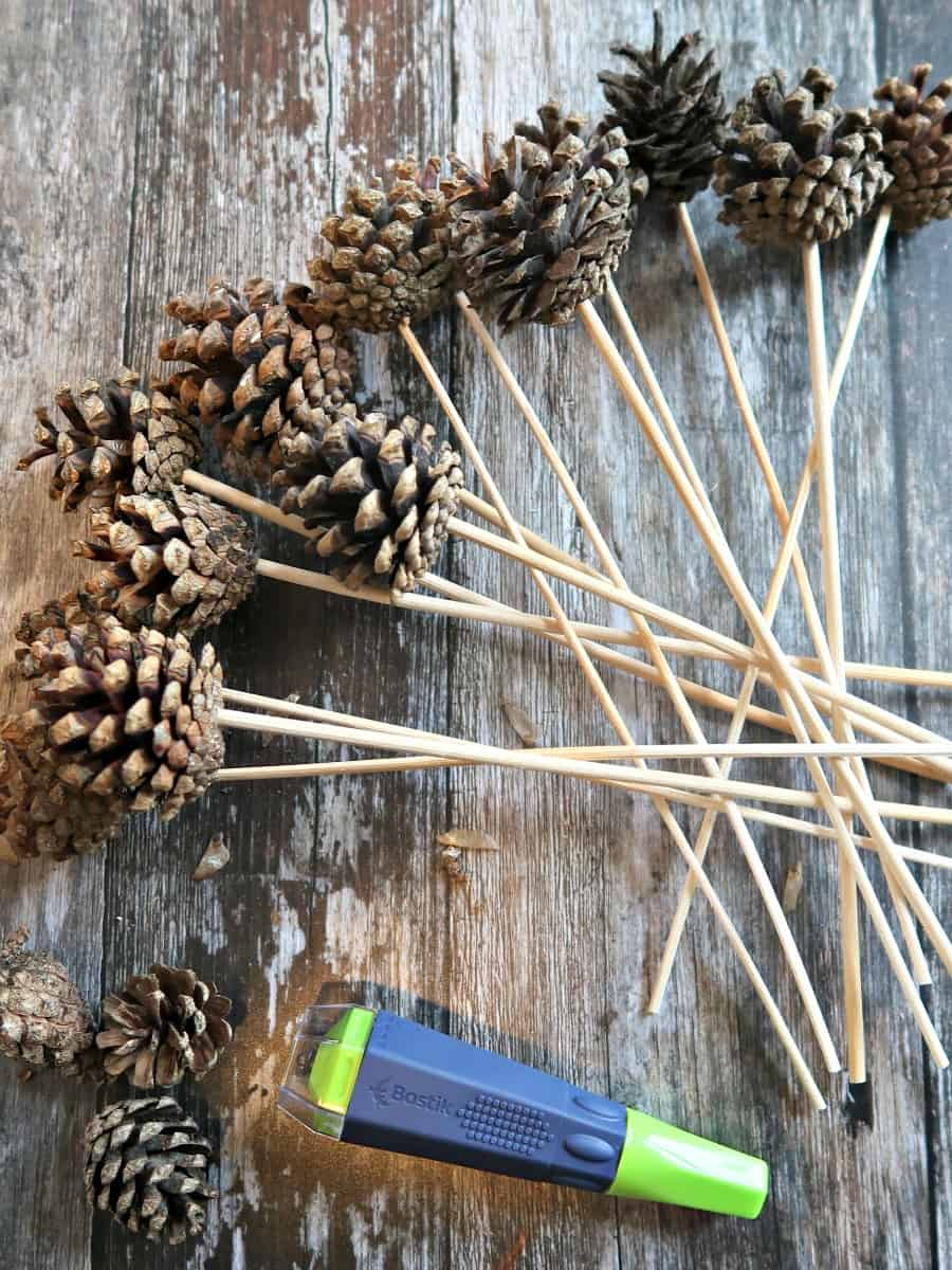 Pine cone picks are an easy way to include pine cones in your festive wreaths and flower arranging. Here we show you how to make them in literally a flash.