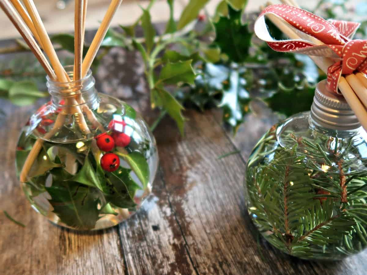 These Christmas reed diffusers use fillable Christmas baubles as diffuser bottles and Christmassy essential oils for fragrance.
